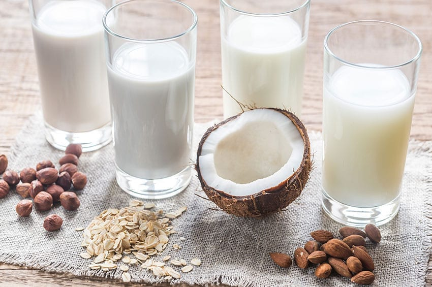 A selection of milk alternatives suitable for a dairy free keto diet.